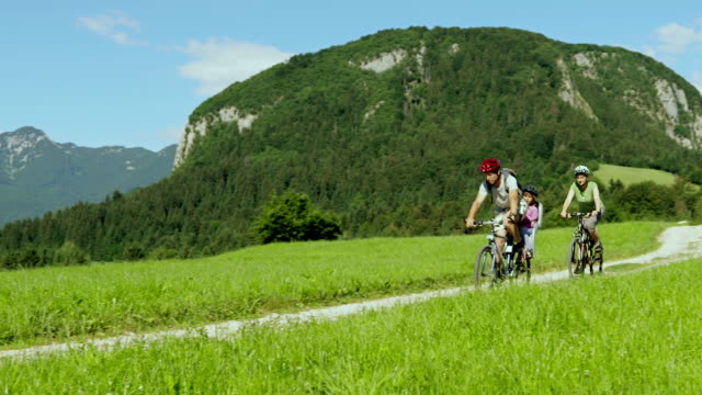 hd: young family on bikes in julian alps - baby carrier stock videos & royalty-free footage