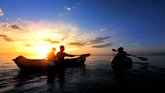 WS Young Family Sea Kayaking At Sunset