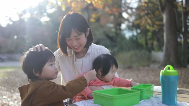 young family taking a break in public park - only japanese stock videos & royalty-free footage