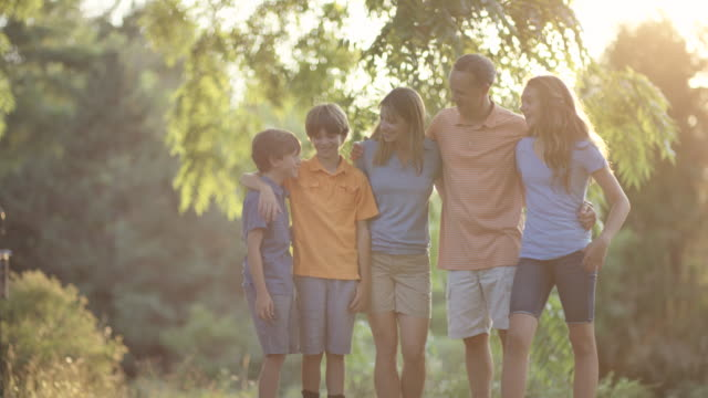 young family together out in nature - family with three children stock videos & royalty-free footage