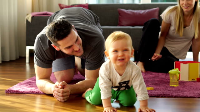 young family with toddler at home - crawling stock videos & royalty-free footage