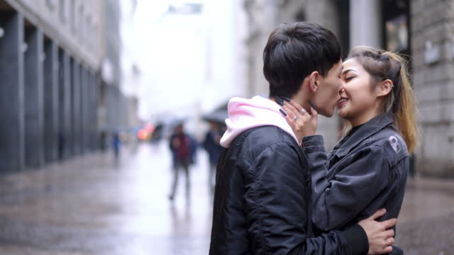 young fashion lovers at beginning of love story - kissing stock videos & royalty-free footage