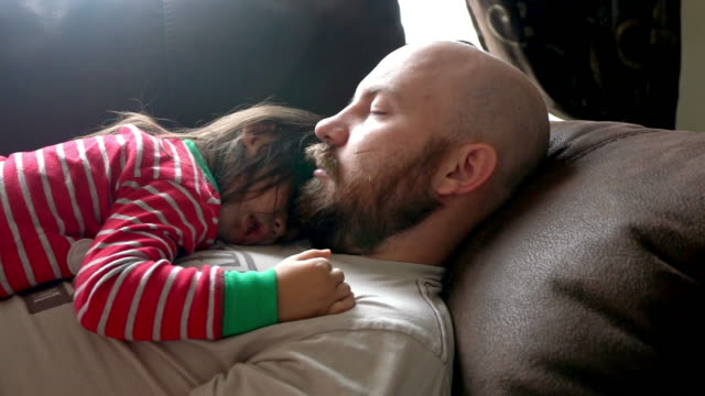 young father and daughter taking a nap on a couch - napping stock videos & royalty-free footage