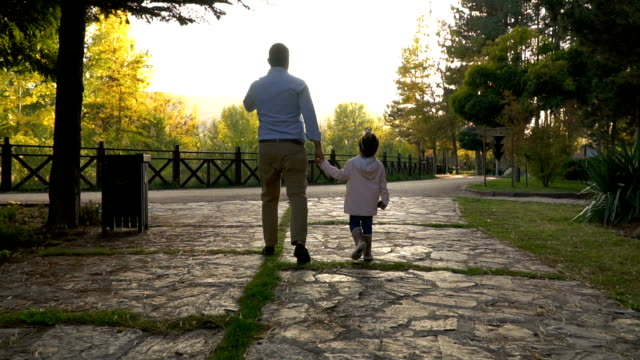 young father and daughter walking in public park - single father stock videos & royalty-free footage