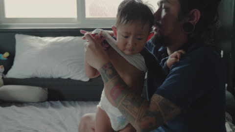young father and his boy getting dressed - routine stock videos & royalty-free footage