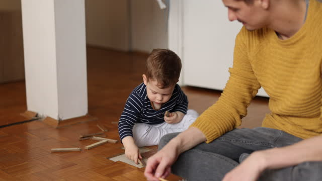 young father and little son playing at home - foster care stock videos & royalty-free footage