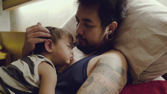 young father at home with little baby boy - semplicità video stock e b–roll