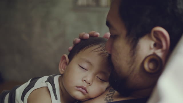 young father at home with little baby boy - chest kissing stock videos & royalty-free footage