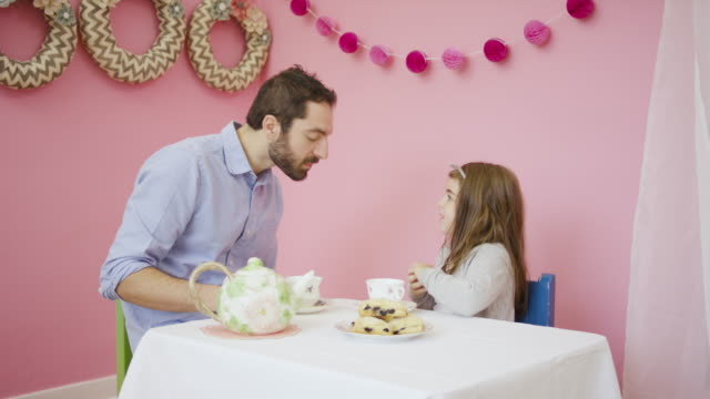 young father having a tea party with his adorable daughter - tea party stock videos and b-roll footage