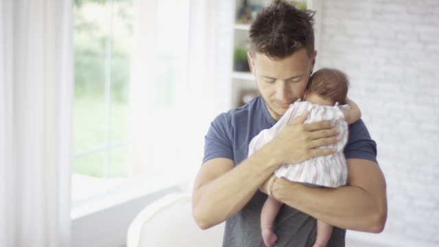 young father patting newborn baby on her back - fatcamera baby stock videos and b-roll footage