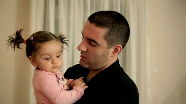 young father playing whit his adorable daughter - genderblend stock videos & royalty-free footage
