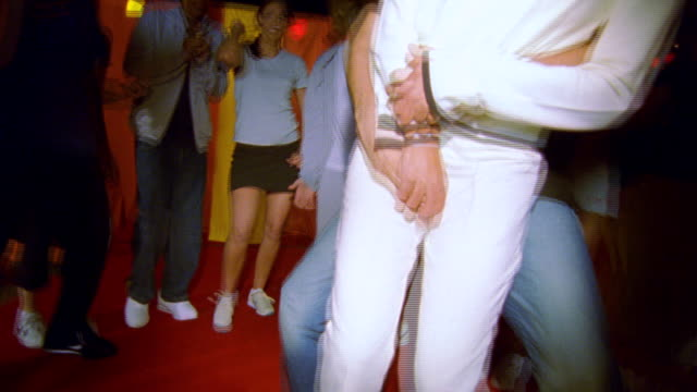 ms young female and male dancing at roof top party  / portland, or, united states - dach stock-videos und b-roll-filmmaterial