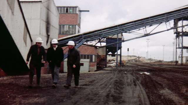 1970 zo young female apprentice walking with miners touring the monktonhall colliery / midlothian, scotland, united kingdom - 1970 stock-videos und b-roll-filmmaterial