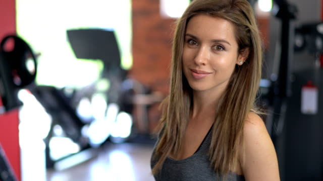 Young female at the gym looking at camera