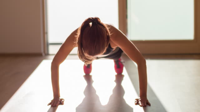 Young female athlete doing push ups