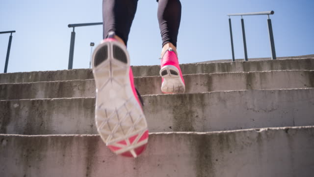 young female athlete running up the stairs - staircase stock videos & royalty-free footage