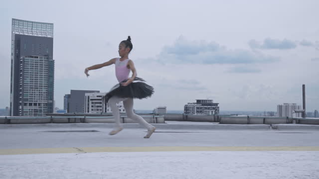 young female ballet dancing on top building , graceful woman spinning in ballet - ballet shoe stock videos & royalty-free footage