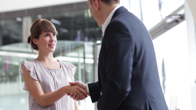 young female businesswoman being offered a job - job interview stock videos and b-roll footage