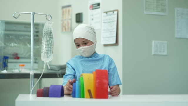 young female cancer patient wearing headscarf and mask - childhood stock videos & royalty-free footage