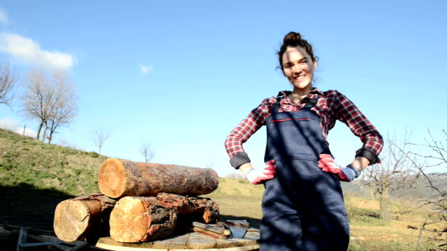 Young female carpenter posing outdoors