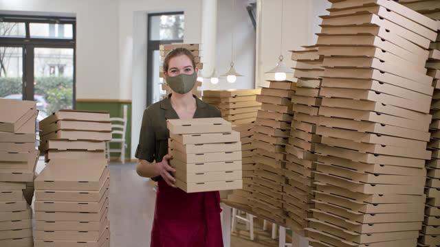 young female company founder in her own organic pizzeria restaurant with protective face mask - viele gegenstände stock-videos und b-roll-filmmaterial