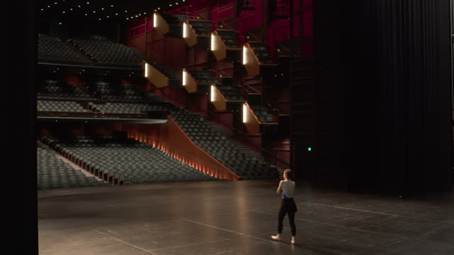 young female dancer entering stage and rehearsing ballet dance. - stato di washington video stock e b–roll
