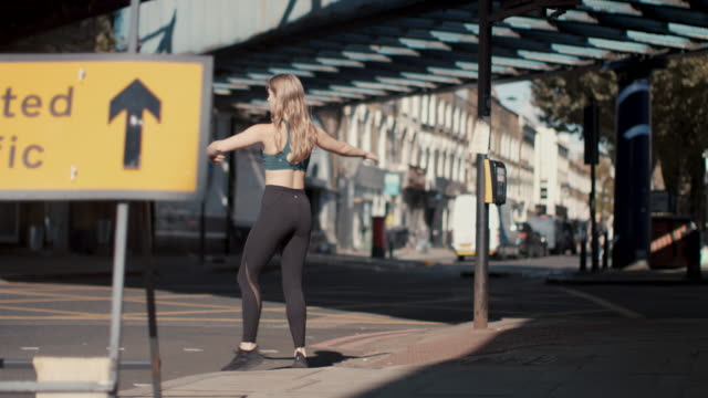 young female dancer exercising in the city - balance stock videos & royalty-free footage