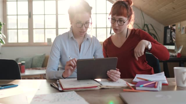 young female designers working together to increase productivity - freelance work stock videos & royalty-free footage