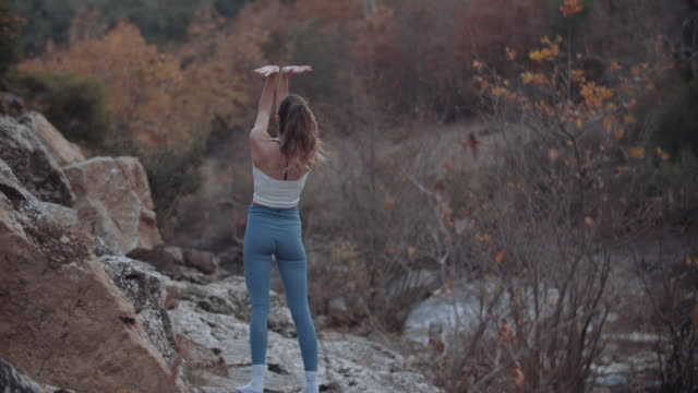 young female do stretching exercises in nature - 10 seconds or greater stock videos & royalty-free footage