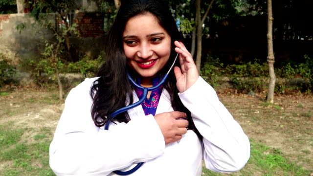 young female doctor of indian ethnicity listen to heartbeat with stethoscope - human internal organ stock videos & royalty-free footage