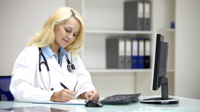 Young female doctor talking with patient in doctor's office