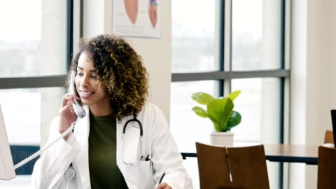 young female doctor working in her office - medical clinic stock videos & royalty-free footage