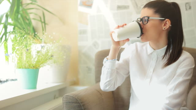 Young female drinking her coffee.