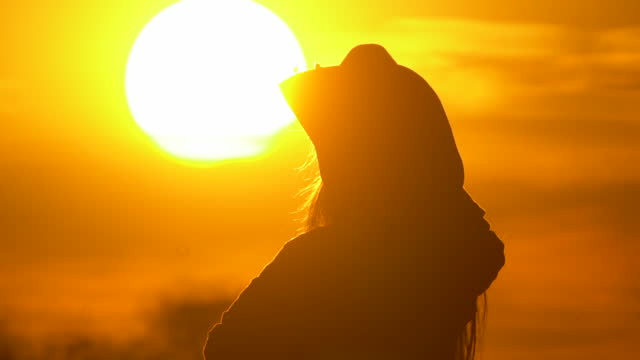 young female farmer in hat at sunset - sunny stock videos & royalty-free footage