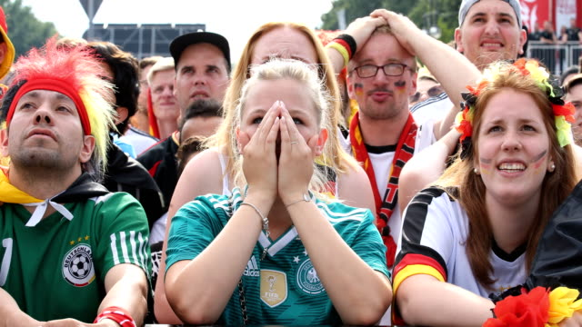 young female football fan in a football shirt is holding her hands in front of her face and has no hope anymore while germany is loosing the 2018... - fußballweltmeisterschaft stock-videos und b-roll-filmmaterial