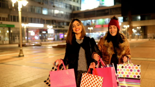 Young female friends  in shopping