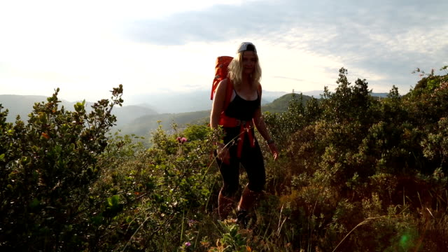 Young female hiker explores Mediterranean hilltop