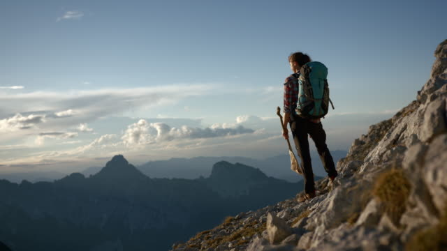 young female hiker standing on the side of a mountain - austria stock videos & royalty-free footage
