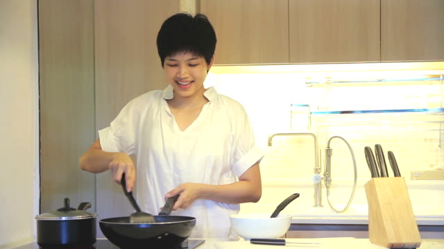 HD : Young Female is cooking in kitchen