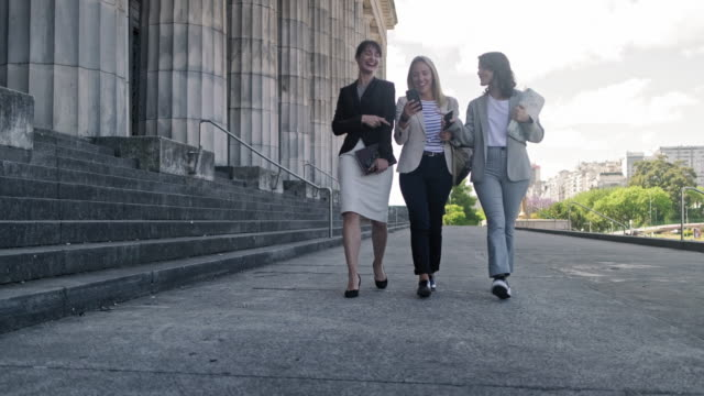 young female law students walking outside school building - law stock videos & royalty-free footage