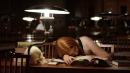 DS Young female medical student falling asleep in library
