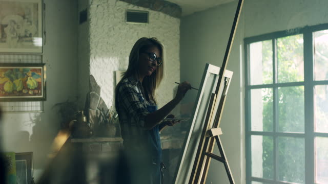 Young female painter at the artist's studio