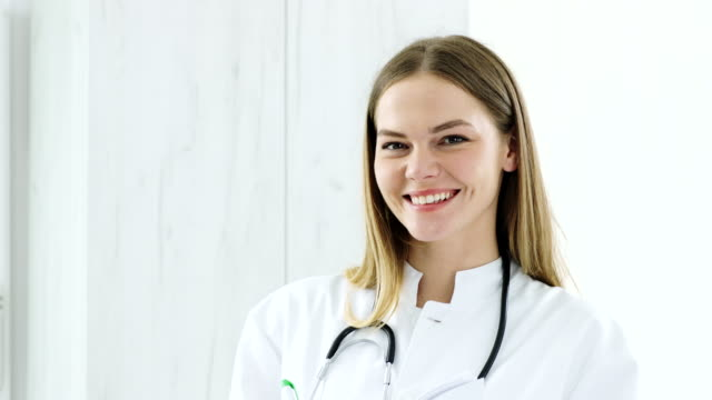young female pediatrician - beautiful people stock videos & royalty-free footage