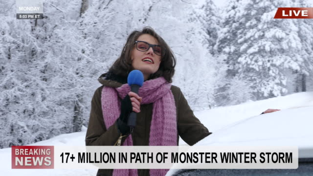 young female reporter presenting snow situation in mountains - weather stock videos & royalty-free footage