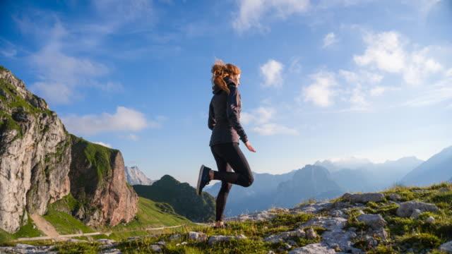 vídeos de stock e filmes b-roll de young female runner training in the mountains - exhaustion