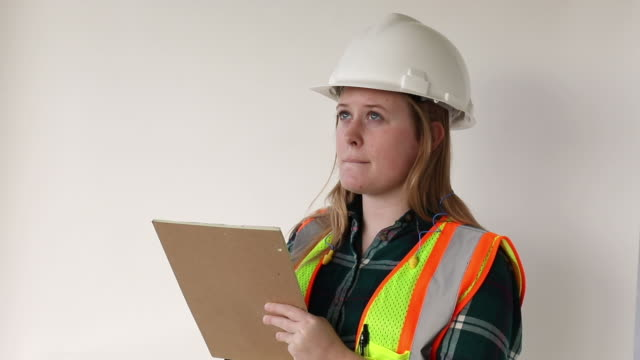 young female safety professional performing an inspection - genderblend stock videos & royalty-free footage