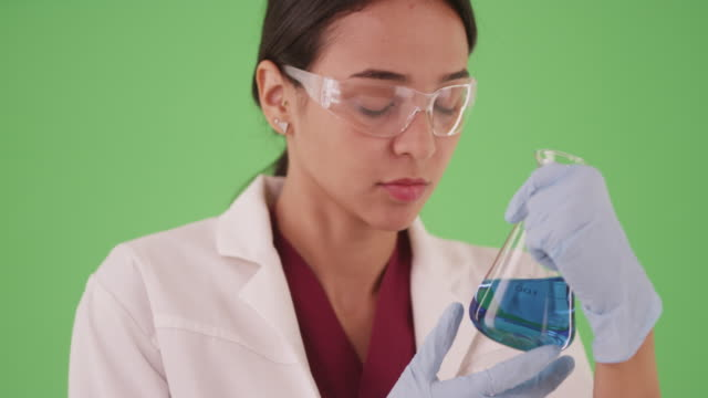 young female scientist or medical researcher with blood samples on greenscreen - medical student stock videos and b-roll footage