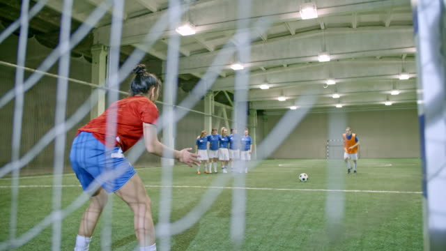 young female soccer goalie failing to save penalty kick - women's football stock videos & royalty-free footage