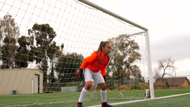 ms young female soccer goalie stopping shot on goal - goalkeeper stock videos & royalty-free footage