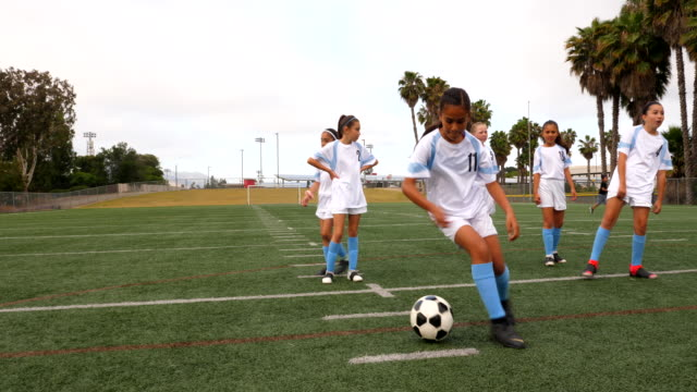 ms young female soccer player dribbling ball during drills with teammates on field - pacific islander girl stock videos & royalty-free footage